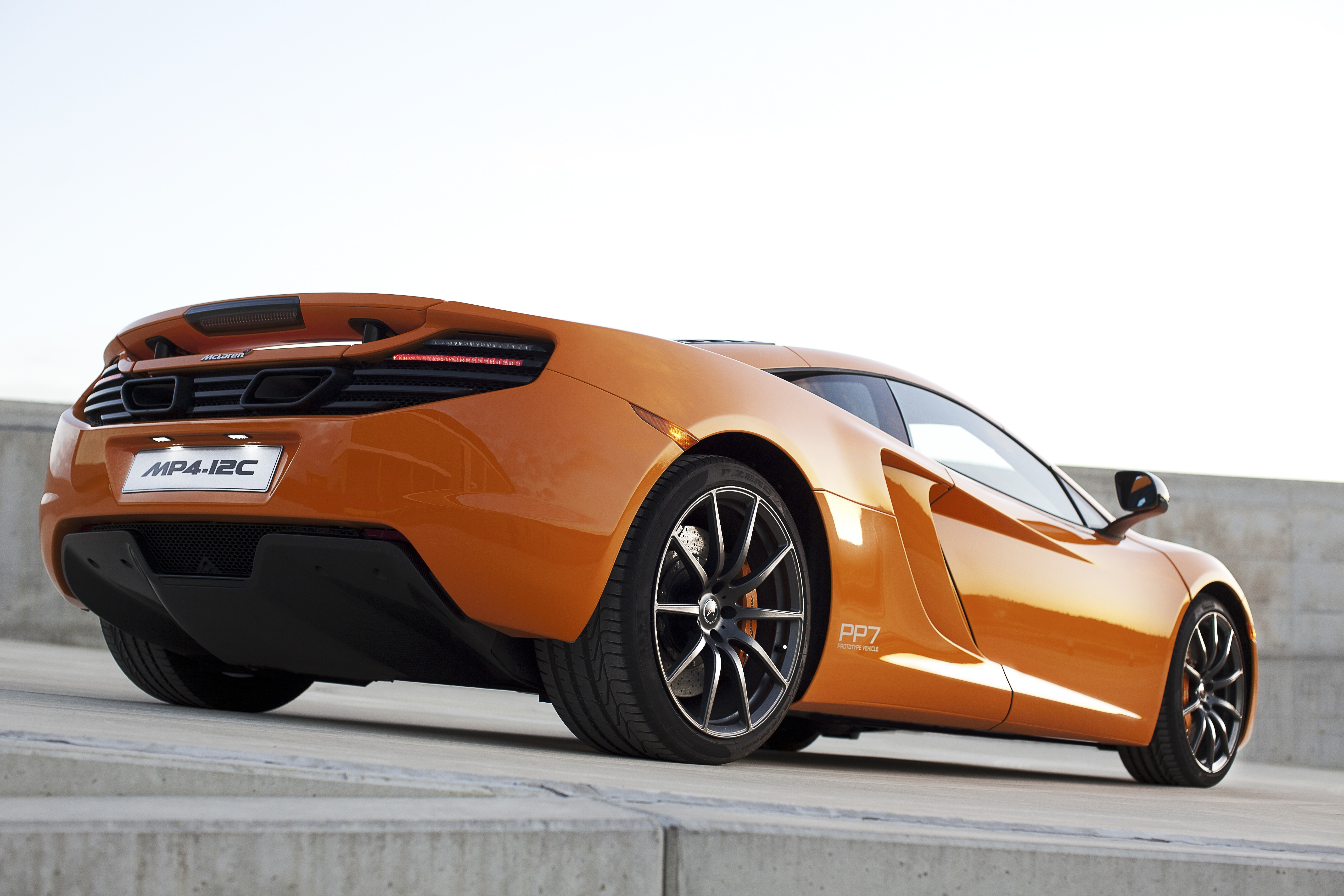 McLaren MP4-12C 2012 bright orange PP7 rear