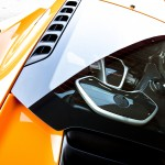 McLaren MP4-12C 2012 bright orange engine bay detail