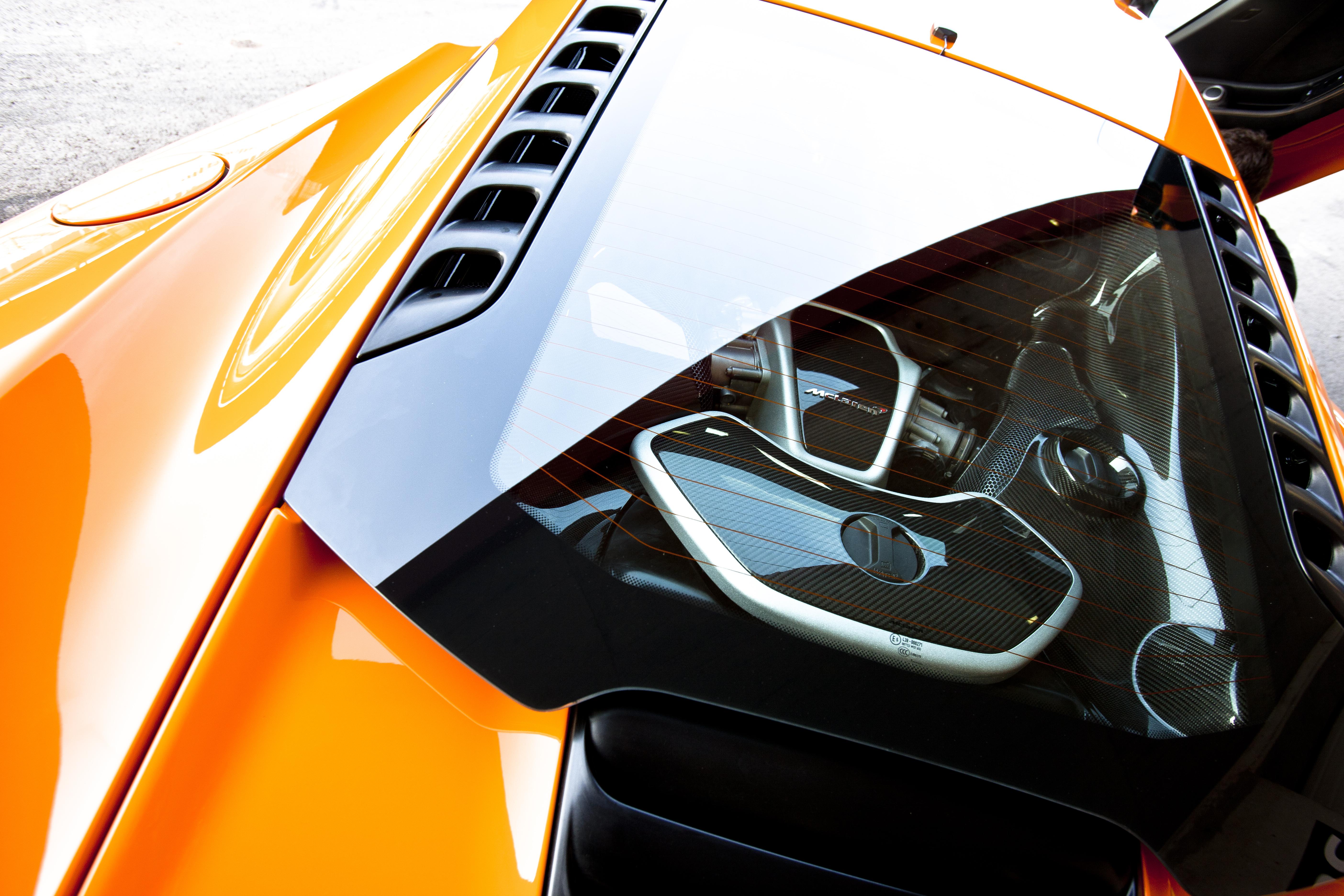 McLaren MP4-12C 2012 bright orange engine bay detail