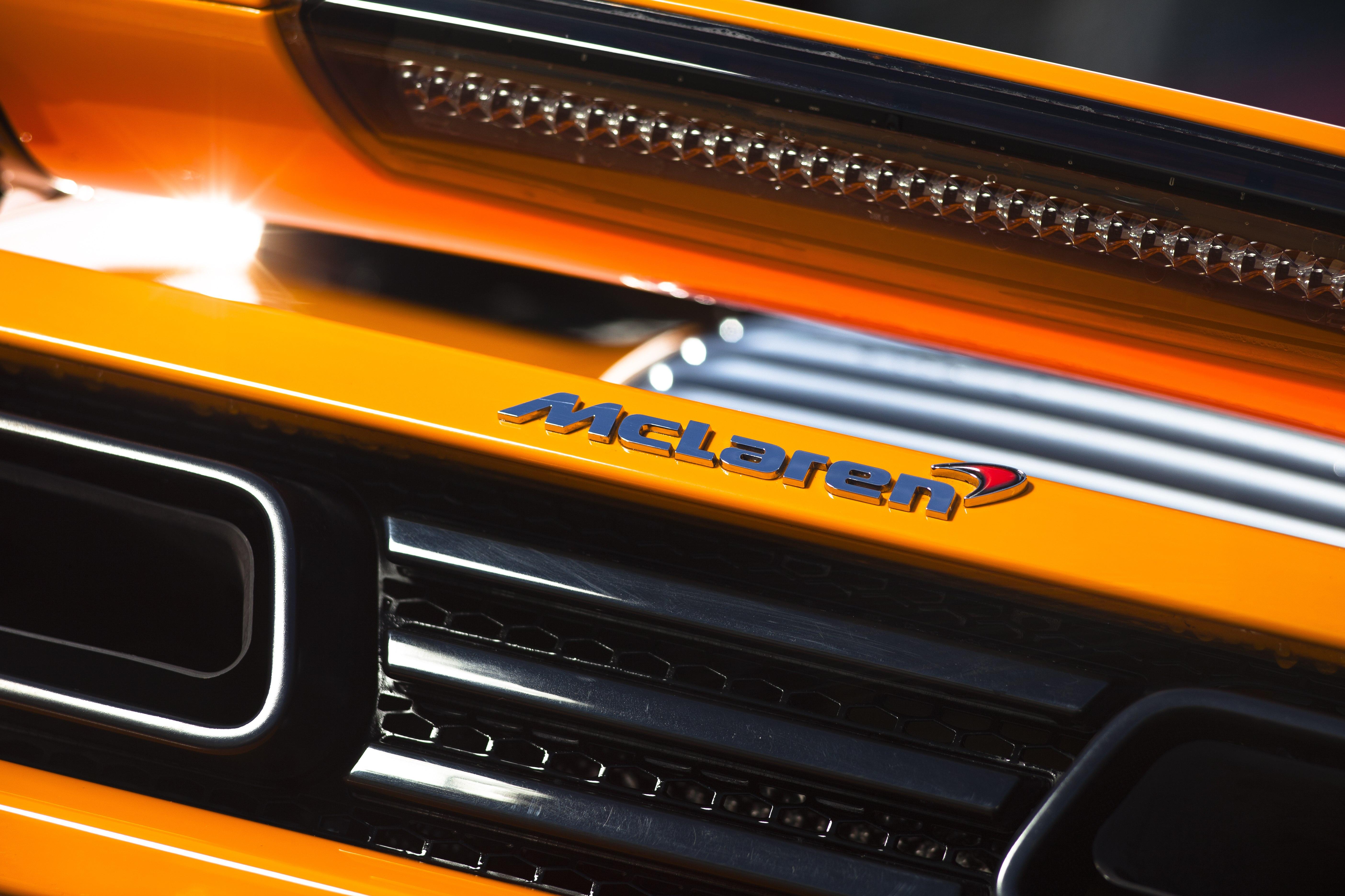 McLaren MP4-12C 2012 bright orange rear badge detail