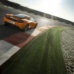 McLaren MP4-12C 2012 bright orange rear speed sun