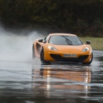 McLaren MP4-12C 2012 bright orange speed drift standing water