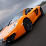 McLaren MP4-12C 2012 bright orange speed front airstrip