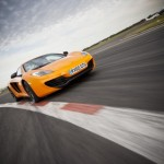 McLaren MP4-12C 2012 bright orange speed front corner