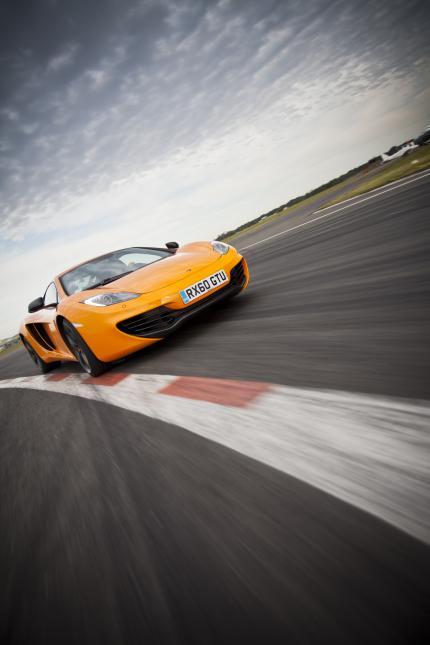 McLaren MP4-12C 2012 bright orange speed front corner
