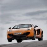 McLaren MP4-12C 2012 bright orange speed jump