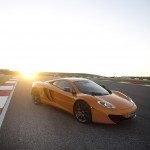 McLaren MP4-12C 2012 bright orange sunset front airstrip