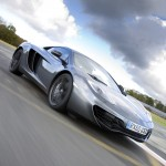 McLaren MP4-12C 2012 grey speed front low airstrip close