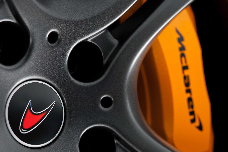 McLaren MP4-12C 2012 orange brake caliper detail