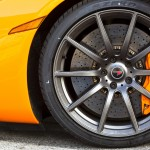 McLaren MP4-12C 2012 orange front wheel and brake caliper detail