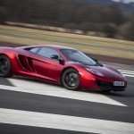 McLaren MP4-12C 2012 red oversteer drift front airstrip