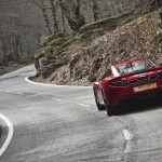McLaren MP4-12C 2012 red rear twisty road
