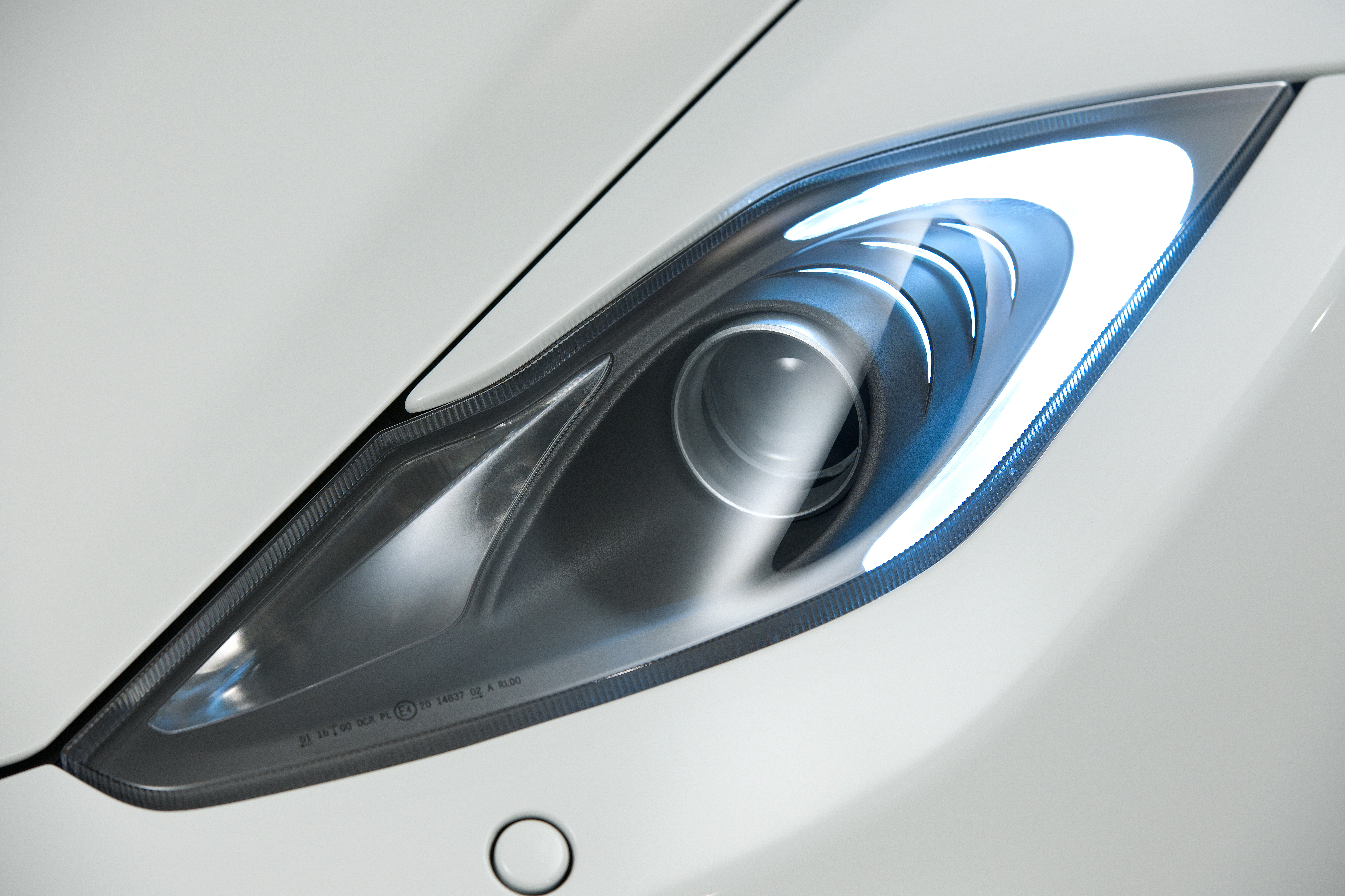McLaren MP4-12C 2012 white front light detail