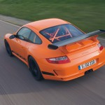 Porsche 911 GT3 RS 997 black orange top rear track motion