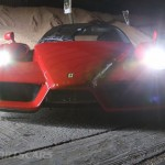 Ferrari Enzo WRC hooning rally off road extreme front with tractor in barn