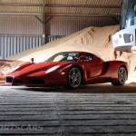 Ferrari Enzo WRC hooning rally off road extreme front with tractor in barn low