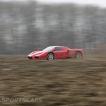 Ferrari Enzo WRC hooning rally off road extreme side muddy at speed