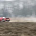 Ferrari Enzo WRC hooning rally off road extreme side rear muddy at speed