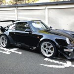 RWB Porsche 911 Rauh-Welt Begriff 964 black with chrome alloy wheels