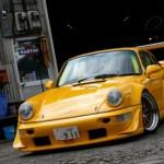 RWB Porsche 911 Rauh-Welt Begriff 964 orange angle and stance front