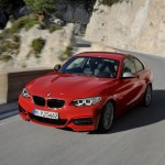 BMW M235i launch red front angle at speed (1280x853)