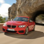 BMW M235i launch red front at speed (1280x853)