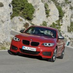 BMW M235i launch red front speed low angle (1280x853)