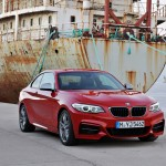 BMW M235i launch red harbour angle front (1280x853)