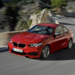 BMW M235i launch red motion from front on mountain pass (1280x853)