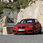 BMW M235i launch red mountain pass front stance (1280x853)