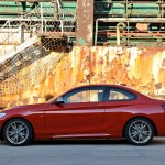 BMW M235i launch red nearside harbour (1280x853)