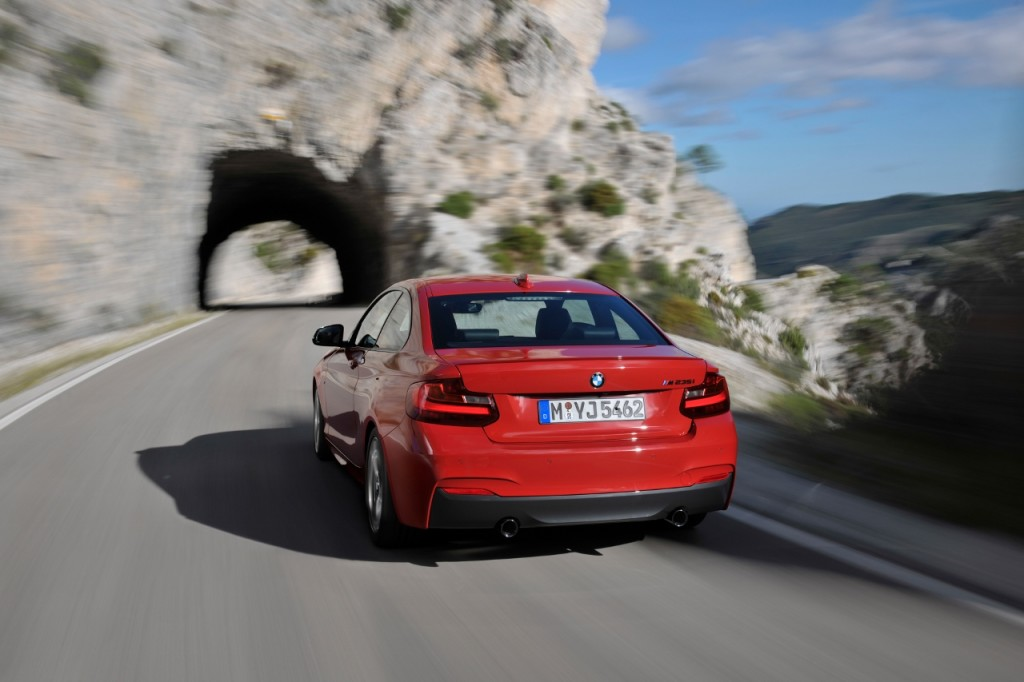 BMW M235i launch red rear at speed (1280x853)