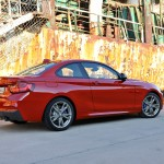 BMW M235i launch red rear three quarter angle (1280x853)