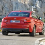 BMW M235i launch red rer low angle at speed (1280x853)