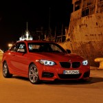 BMW M235i launch red side night (1280x853)